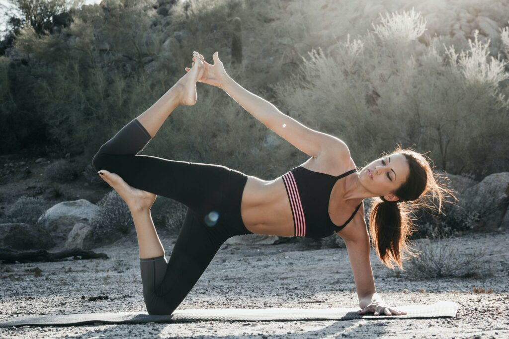 Woman holding yoga pose in the desert