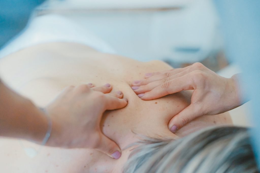 woman back shoulder massage